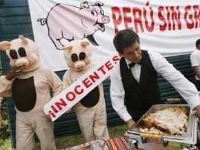 Свиной грипп добрался до Малайзии и Перу