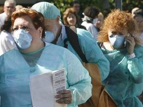 С подозрением на свиной грипп госпитализированы 7 испанцев и итальянка