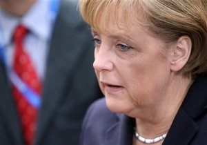Меркель может не попасть на похороны Качиньского