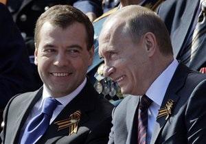 Медведев и Путин разрешили использовать свои лица на выборах
