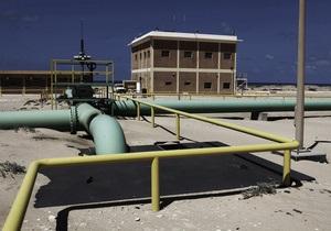 Самолеты Каддафи уничтожают нефтяные резервуары в Мисрате