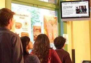 Газета The New York Times арендует сеть мониторов в кафе и супермаркетах