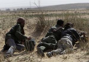 В результате обстрела войсками Каддафи погибли 11 повстанцев