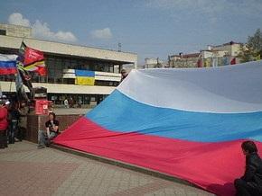 УНА-УНСО возмущена крымской акцией В каждом окне - российский флаг