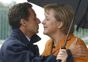 Опрос: французы доверяют Меркель больше, чем своему президенту Саркози