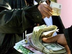 Эксперты: Среднегодовой курс доллара составит 12 гривен за доллар