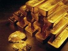 Золото поставило рекорд, достигнув тысячи долларов