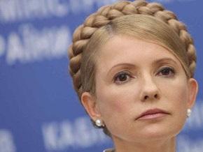 Тимошенко обратится в международные организации, если НБУ не стабилизирует гривну
