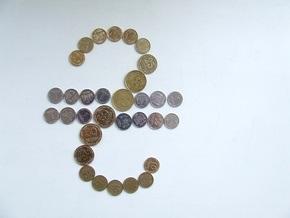 НБУ понизил официальный курс гривны на 9 копеек