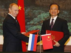 Путин вручил премьеру Китая медаль и толковый словарь русского языка