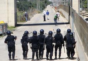 Около 35 человек пострадало в Италии при столкновениях иммигрантов с полицией