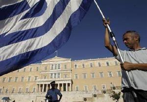 Греция намерена занять два миллиарда евро в ожидании кредита от ЕС и МВФ