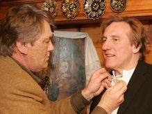 Друг Ющенко заплатит за избиение папарацци