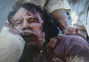ПНС расследует сообщения о том, что Каддафи насиловали перед смертью