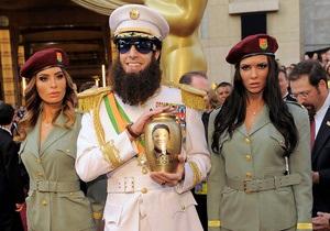 Фотогалерея: Оскар-2012. Гості, вбрання і  прах Кім Чен Іра  на Червоній доріжці