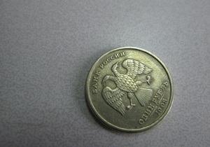 Рубль - долар - валюта - Рубль докотився до нового річного мінімуму до долара