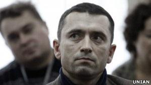 Опозиція просить Італію дати притулок Романюку