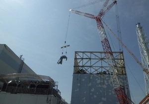 Над першим енергоблоком аварійної АЕС Фукусіма-1 завершено будівництво металевого каркаса для захисного купола.