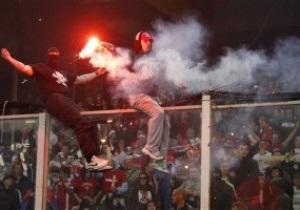 Побоище между фанами и полицией сорвало матч Италия - Сербия
