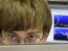 Рынки: Фиксация прибыли давит на индексы