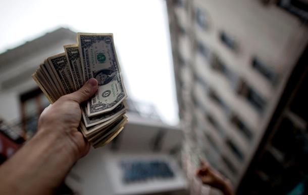 Цены на межбанковский доллар понизились