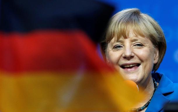 ангела меркель улыбается - флаг германии - Больше всего новых рабочих мест за минувший год было создано в строительной отрасли и в сфере услуг