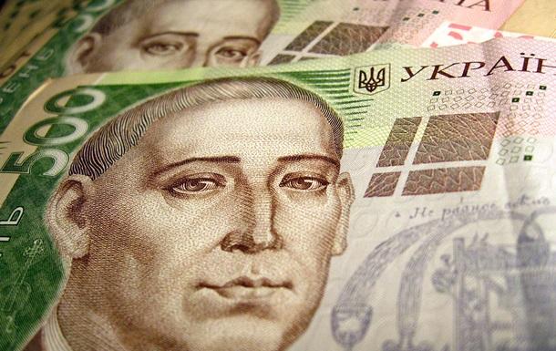 Курс гривны снизился до 9,14 грн за доллар