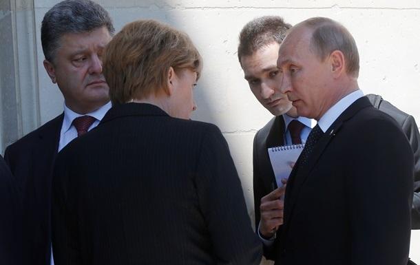 В сети появилось видео беседы Меркель, Порошенко и Путина