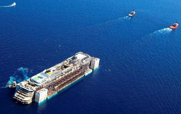 Началась буксировка затонувшего лайнера Costa Concordia