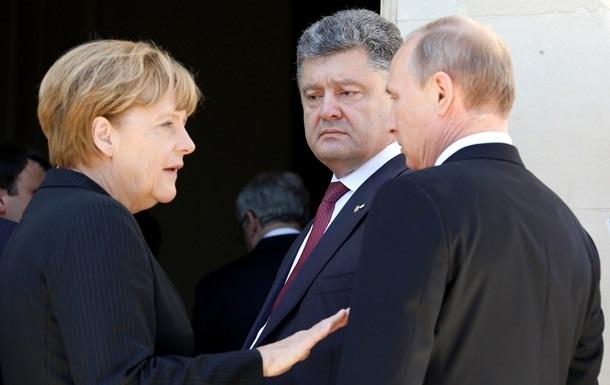 Путин, Меркель и Порошенко согласовали новые шаги по Донбассу