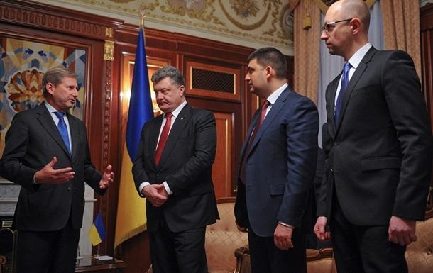 Єврокомісар Ган у Києві: Україні потрібні мир та реформи