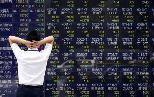 Китайские биржи снова остановились из-за обвала индексов