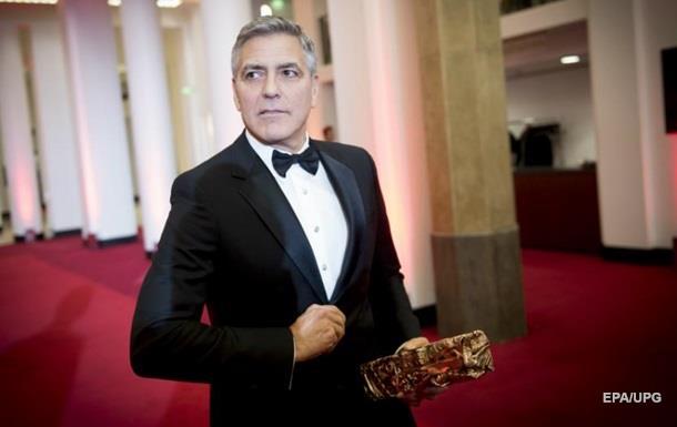 Клуни будет судиться с журналом за публикацию фото его детей