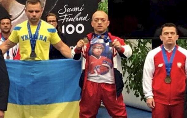 Пауерліфтера з РФ дискваліфікували за Путіна