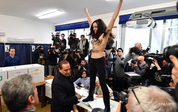 Femen попыталась помешать Берлускони проголосовать