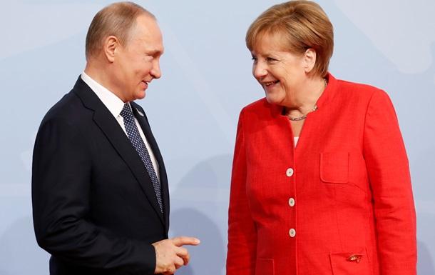 Меркель и Путин обмениваются продуктами