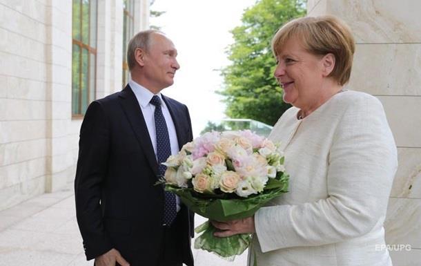 Путін дав Україні гарантії? ЗМІ про візит Меркель