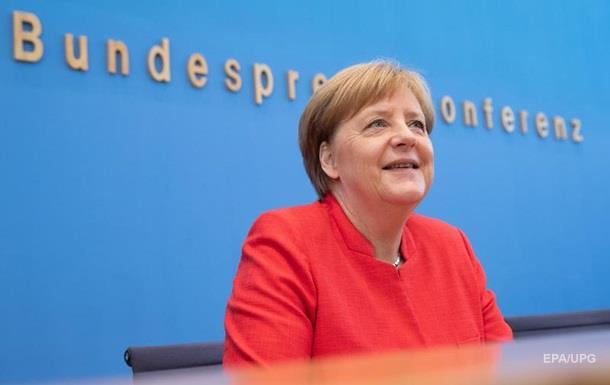 Меркель советует Трампу и Путину чаще встречаться