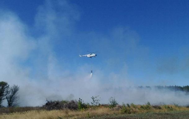 Під Балаклією вертольоти гасять пожежу на звалищі