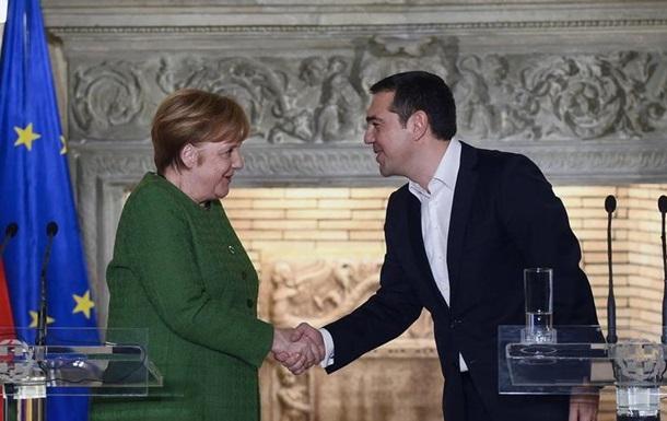 Меркель у Ципраса: похвала за реформи та угоду з Македонію