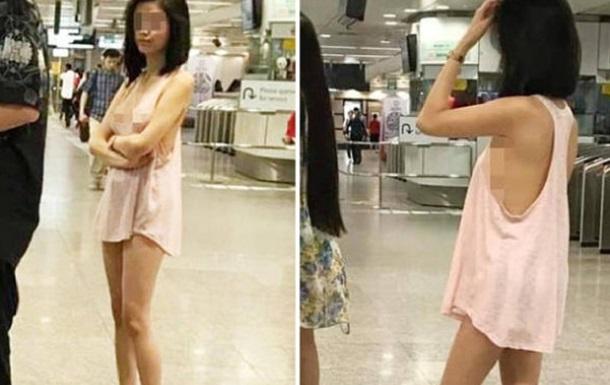 Полуголая азиатка проехалась в метро Сингапура