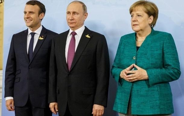У Кремлі розповіли, про що Путін говорив з Меркель і Макроном