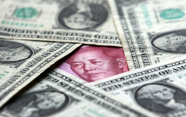 Валютна війна США і Китаю. Що пригнітить світ