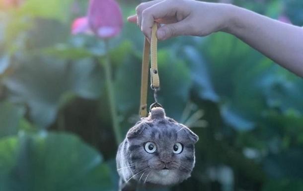 Дизайнер делает жутковатые сумки  из кошек : фото