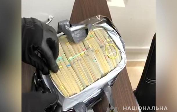 У Києві копи вилучили $400 тисяч  злодійської каси