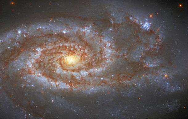 Показано місце Землі  на задвір ї  галактики