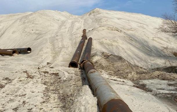 На Київщині директора ТОВ підозрюють у заволодінні піском на 88 млн грн