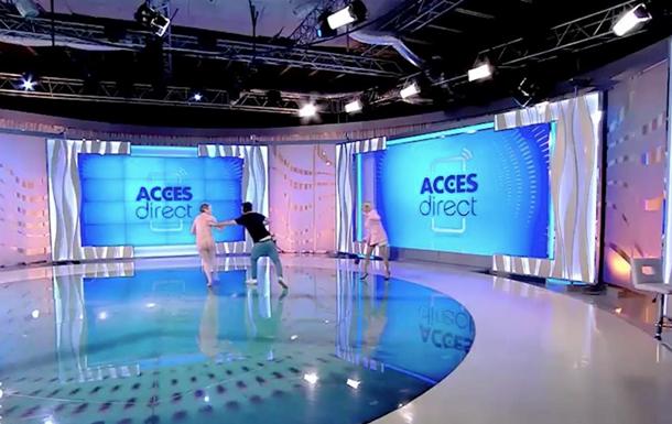 Гола жінка в прямому ефірі напала на телеведучу